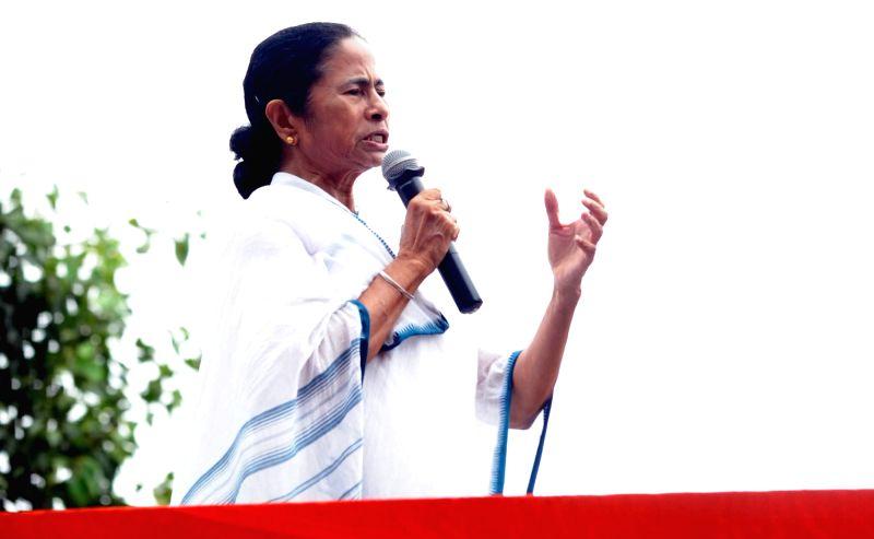 :Kolkata: West Bengal Chief Minister and Trinamool Congress (TMC) supremo Mamata Banerjee addresses at party's Martyrs' Day rally, in Kolkata on July 21, 2018. (Photo: Kuntal ...