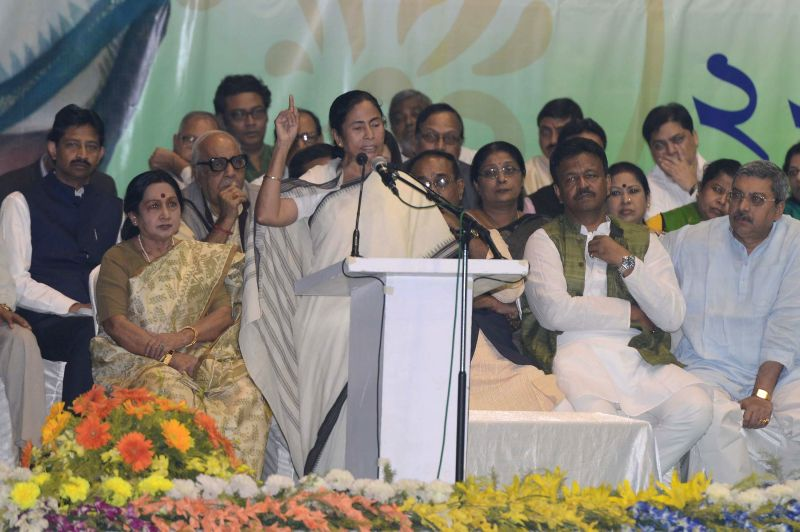West Bengal Chief Minister Mamata Banerjee addresses during a workers meeting in Kolkata on Nov 22, 2014.