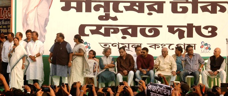 West Bengal Chief Minister Mamata Banerjee leads a rally to protest against central government in Kolkata, on Nov 24, 2014. Also seen West Bengal Education Minister Partha Chatterjee, ... - Partha Chatterjee