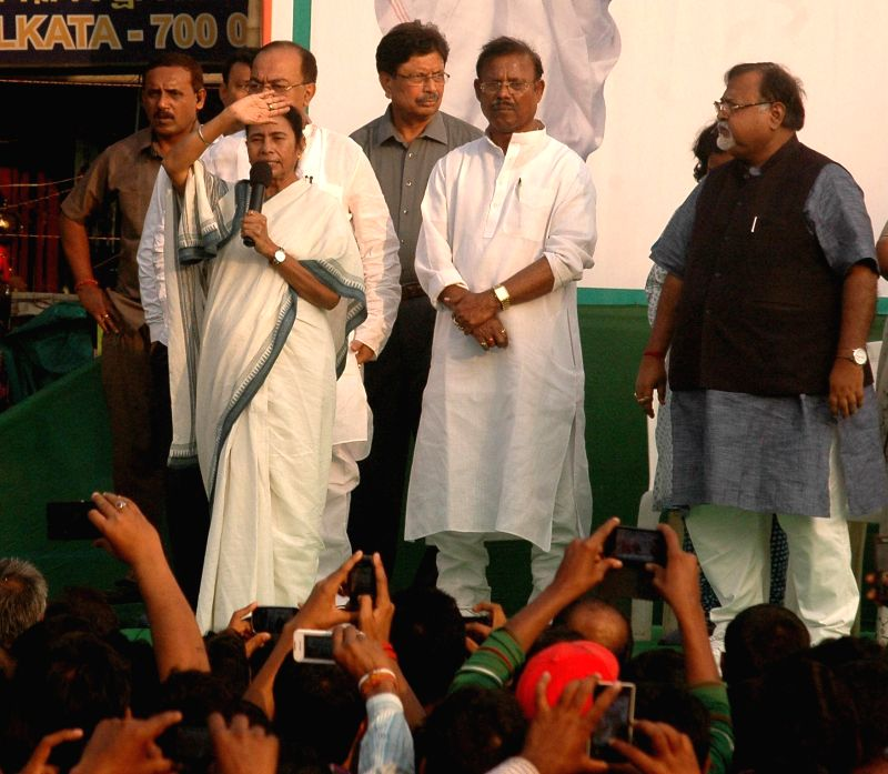 West Bengal Chief Minister Mamata Banerjee leads a rally to protest against central government in Kolkata, on Nov 24, 2014. Also seen West Bengal Education Minister Partha Chatterjee and ... - Partha Chatterjee