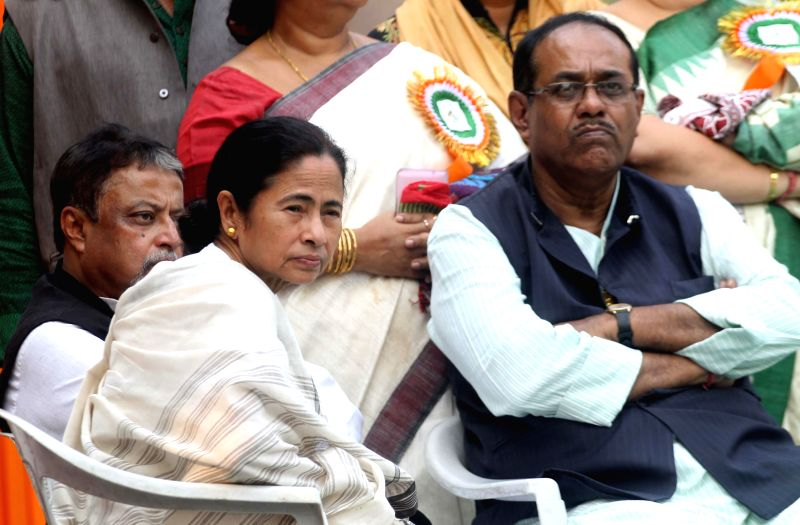 West Bengal Chief Minister Mamata Banerjee Mamata Banerjee during `Sanghati Diwas` or Integration Day in Kolkata  on Dec. 6, 2014. Also seen Trinamool Congress leader Mukul Roy. - Mamata Banerjee Mamata Banerjee and Mukul Roy