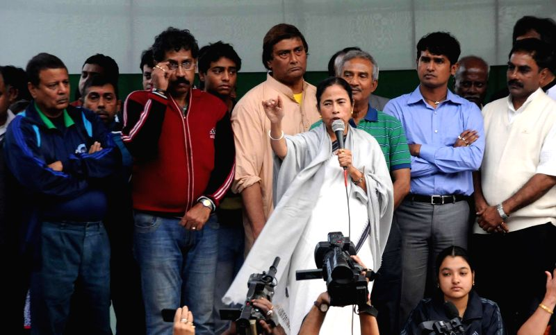 West Bengal Chief Minister Mamata Banerjee with others party workers take part in a protest rally against CBI in Kolkata on Dec. 13, 2014.