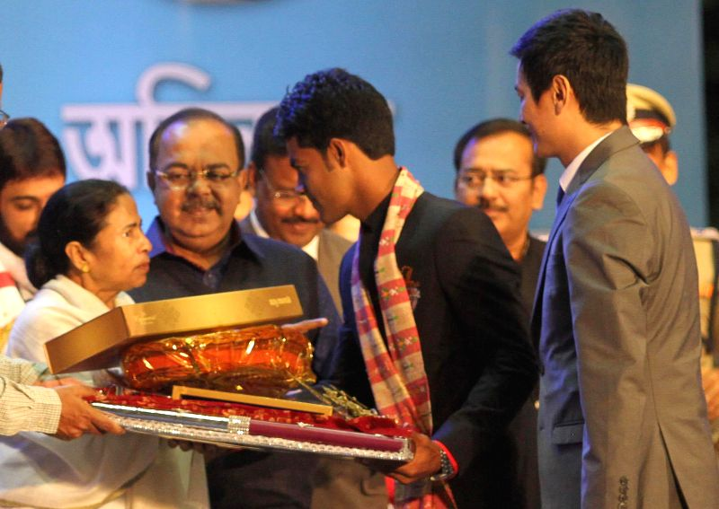 West Bengal Chief minister Mamata Banerjee during the felicitation programme of Atletico de Kolkata at Netaji Indoor stadium in Kolkata on Dec 24, 2014.