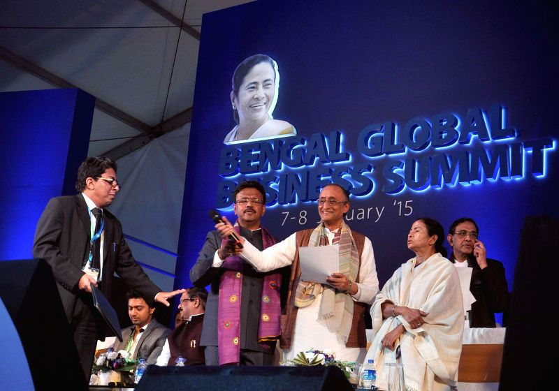 West Bengal Chief Minister Mamata Banerjee, West Bengal Finance and Industry Minister Amit Mitra and Minister for Urban Development Firhad Hakim ​with​ other industrialists at the Bengal - Mamata Banerjee