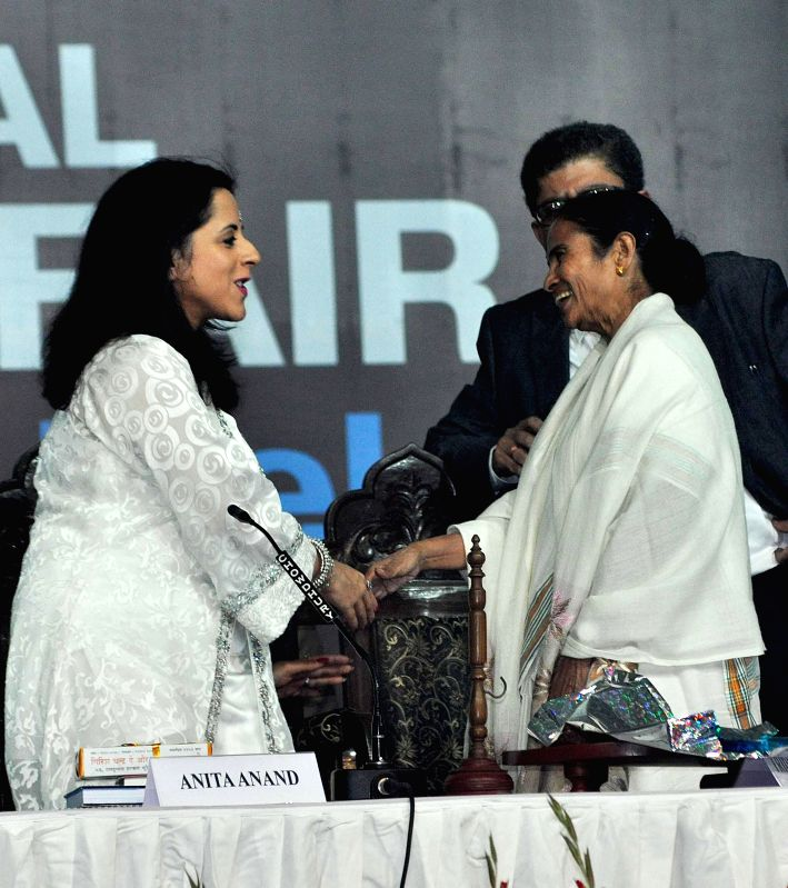 West Bengal Chief Minister Mamata Banerjee and British author Anita Anand during inauguration of 39th International Kolkata Book Fair in Kolkata on Jan 27, 2015. - Mamata Banerjee