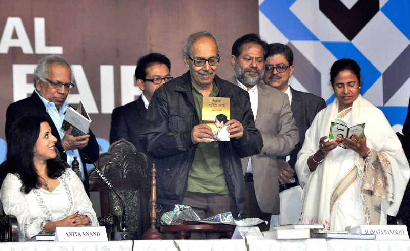 West Bengal Chief Minister Mamata Banerjee , author Sirsendu Mukherjee, British author Anita Anand with other guests during inauguration of 39th International Kolkata Book Fair in Kolkata on - Mamata Banerjee and Sirsendu Mukherjee