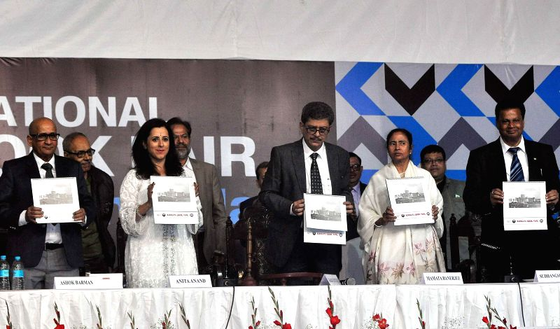 West Bengal Chief Minister Mamata Banerjee, British author Anita Anand with other guests  release a calender during inauguration of 39th International Kolkata Book Fair in Kolkata on Jan 27, - Mamata Banerjee