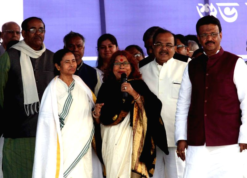 West Bengal Chief Minister Mamata Banerjee with singer Nirmala Mishra during inauguration of a Booster Pumping Station and Water Purification Center in Kolkata on Jan 30, 2015. - Nirmala Mishra