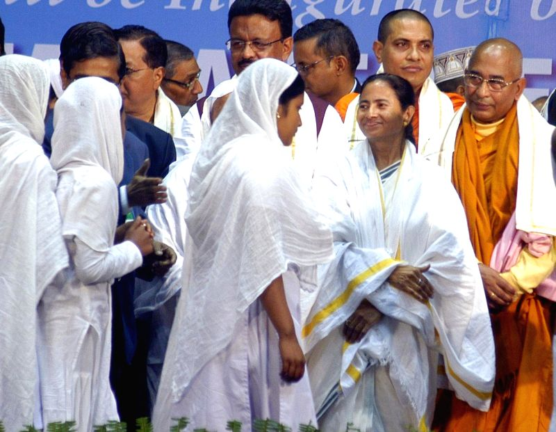 West Bengal Chief Minister Mamata Banerjee offering financial help to minorities during the inauguration of 'Milan Mela 2015'  in Kolkata on Jan 30, 2015.