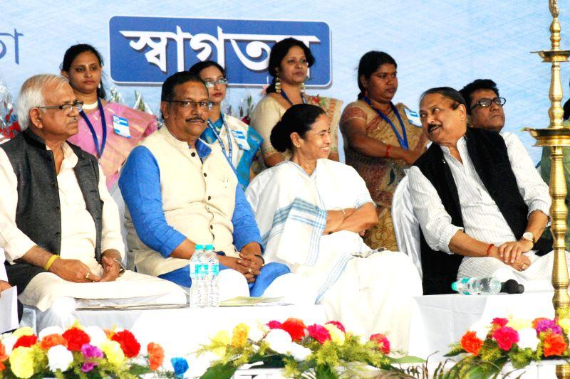 West Bengal Chief Minister Mamata Banerjee during inauguration of Shramik Mela 2015 in Kolkata on Feb 13, 2015. Also seen West Bengal Minister Subrata Mukherjee. - Mamata Banerjee and Subrata Mukherjee