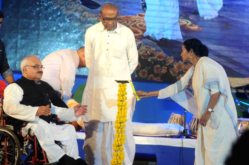West Bengal Chief Minister Mamata Banerjee at the inauguration of `Bangla Sangeetmela` in Kolkata, on Feb 13, 2015. Also seen singers Dwijen Mukherjee and Mohan Singh. - Mamata Banerjee, Dwijen Mukherjee and Mohan Singh