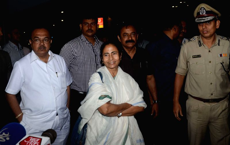 West Bengal Chief Minister Mamata Banerjee arrives at Kolkata Airport before departing for Bangladesh on Feb 19, 2015.