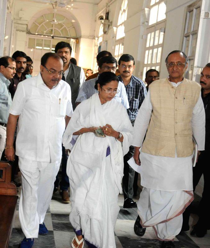 West Bengal Chief Minister Mamata Banerjee, with West Bengal Finance Minister Amit Mitra, Kolkata Mayor Sovan Chatterjee at the West Bengal Legislative Assembly in Kolkata, on Feb 27, 2015. - Mamata Banerjee and Mayor Sovan Chatterjee