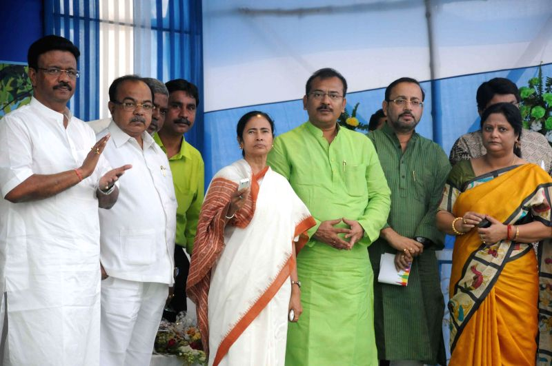 West Bengal Chief Minister Mamata Banerjee with Kolkata Mayor Sovan Chatterjee and West Bengal Housing Minister Arup Biswas at the inauguration of a community center in Kolkata, on March 4, ... - Mamata Banerjee and Mayor Sovan Chatterjee