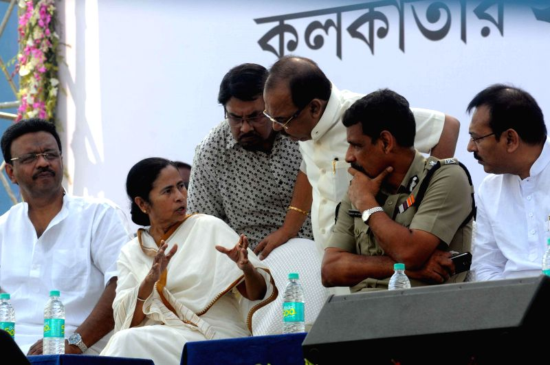 West Bengal Chief Minister Mamata Banerjee and Kolkata Mayor Sovan Chatterjee during a meeting with the hawkers at Rabindra Sarovar in Kolkata on March 13, 2015. Also seen West Bengal Urban ... - Mayor Sovan Chatterjee and Subrata Mukherjee