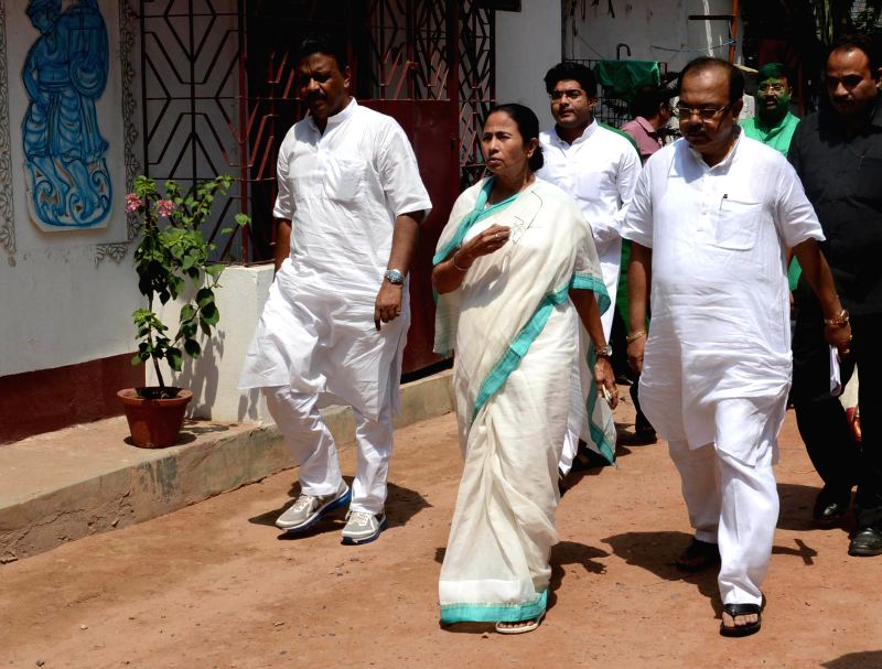 West Bengal Chief Minister Mamata Banerjee with Kolkata mayor-designate Sovan Chatterjee and West Bengal Urban Development Minister Firhad Hakim at her Kalighat residence in Kolkata on April ...