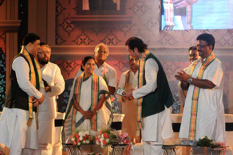 West Bengal Chief Minister Mamata Banerjee with prominent Pakistani politician and grandson of Urdu poet Muhammad Iqbal, Waleed, during a programme organised to felicitate Iqbal in Kolkata, ... - Mamata Banerjee and Sougata Roy