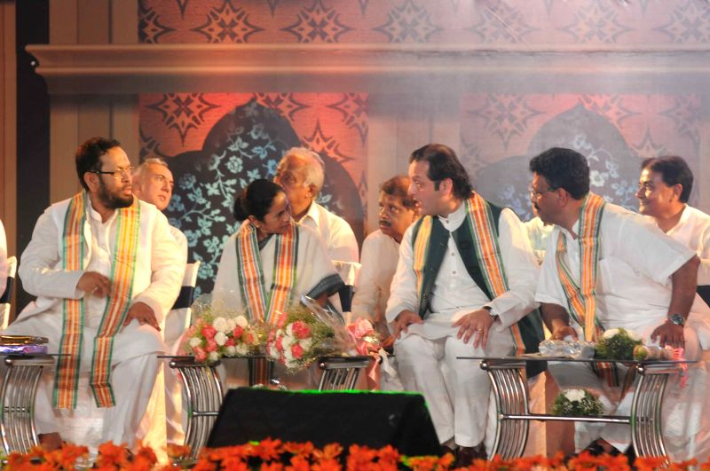 West Bengal Chief Minister Mamata Banerjee with prominent Pakistani politician and grandson of Urdu poet Muhammad Iqbal, Waleed, during a programme organised to felicitate Iqbal in Kolkata, ... - Mamata Banerjee