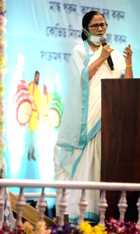 Kolkata: West Bengal Chief Minister Mamata Banerjee addresses during a meeting ahead of Durga Puja celebrations, in Kolkata on Sep 24, 2020. (Photo: IANS)