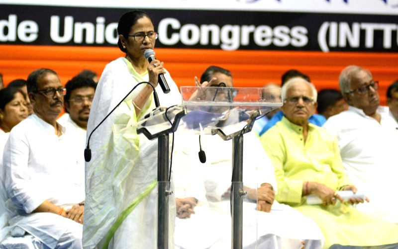 Kolkata: West Bengal Chief Minister Mamata Banerjee addresses during a meeting of the Indian National Trinamool Trade Union Congress (INTTUC) in Kolkata on Sep 23, 2019. (Photo: IANS)