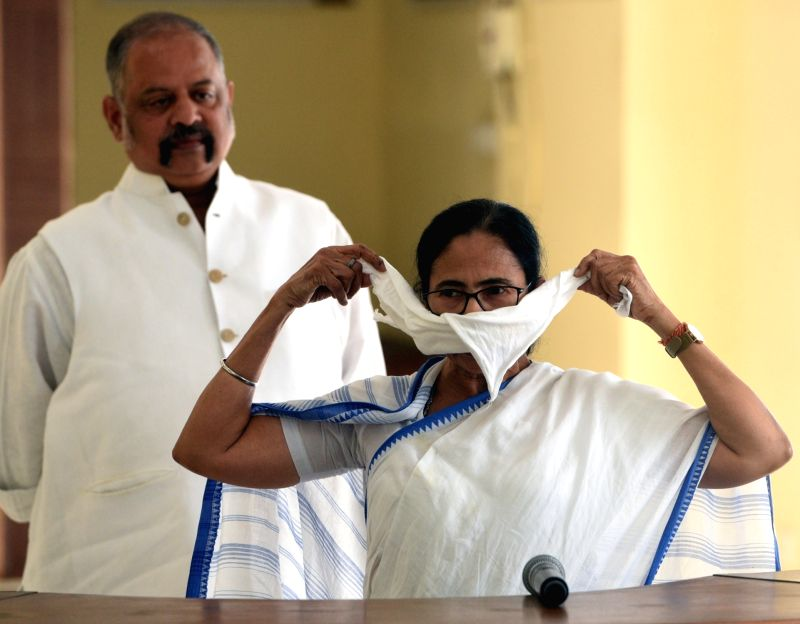 Kolkata: West Bengal Chief Minister Mamata Banerjee addresses the media on precautionary measures that can be followed by the people to stay protected from COVID-19 amid coronavirus pandemic, at Nabanna in Howrah on March 20, 2020. (Photo: IANS)