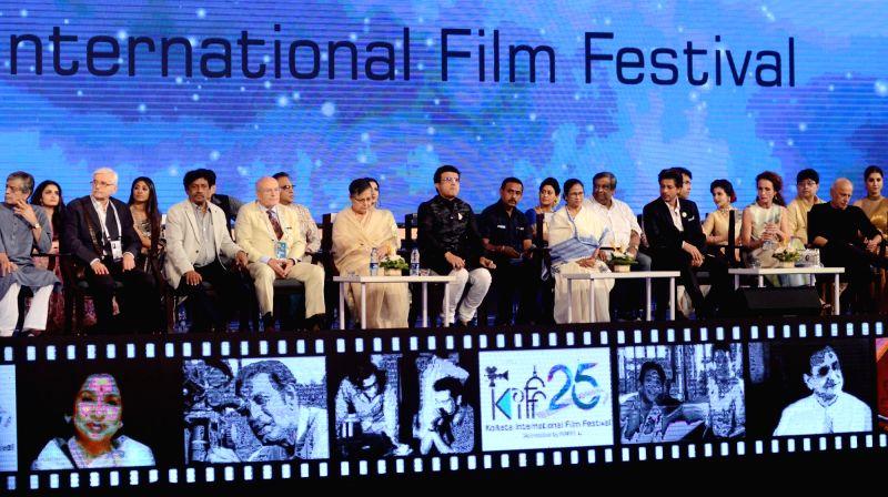 Kolkata: West Bengal Chief Minister Mamata Banerjee, Cabinet Minister Firhad Hakim, BCCI President Sourav Ganguly, filmmaker Mahesh Bhatt and actors Shah Rukh Khan, Rakhee Gulzar and Indrani Haldar at the inaugural session of the 25th Kolkata Interna