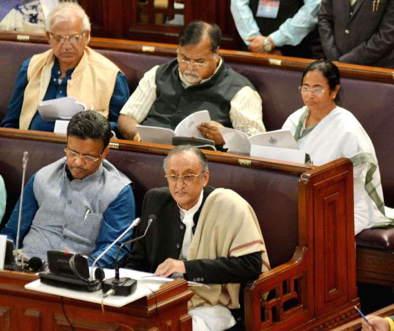 : Kolkata: West Bengal Chief Minister Mamata Banerjee, Finance Minister Amit Mitra and Education Minister Partha Chatterjee during State Budget Session at State Assembly in Kolkata on Jan 31, 2018. ...