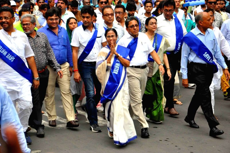 Kolkata: West Bengal Chief Minister Mamata Banerjee participates in a rally organised to create awareness among people on water conservation, in Kolkata on July 12, 2019.