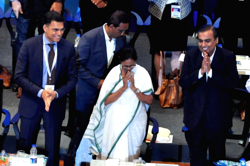West Bengal Chief Minister Mamata Banerjee with Reliance Industries Chairman and Managing Director Mukesh Ambani and JSW Group Chairman Sajjan Jindal at Bengal Global Business Summit (BGBS) 2019 in Kolkata