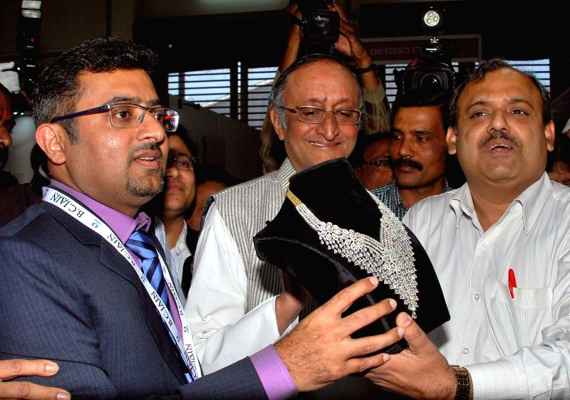 West Bengal Finance and Industry Minister Amit Mitra during inauguration of `Gems & Jewellery Fair 2015` in Kolkata, on Jan 10, 2015. - Amit Mitra