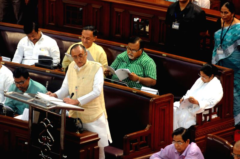 West Bengal Finance Minister Amit Mitra presents the state budget for 2015-16 at the state legislative assembly in Kolkata, on Feb 27, 2015. - Amit Mitra