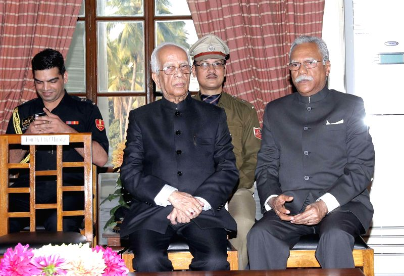 West Bengal Governor K N Tripathi with newly appointed State Chief Information Commissioner West Bengal, K John Koshy at Rajbhavan in Kolkata on Feb. 3, 2015. - K N Tripathi