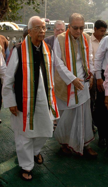 West Bengal Governor Keshari Nath Tripathi with Justice Shyamal Sen offering tribute at the statue of Baba Saheb Dr. BR Ambedkar on the occasion of his `Mahaparinirvan Diwas` in Kolkata on .. - Keshari Nath Tripathi