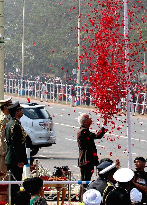 West Bengal Governor Keshari Nath Tripathi hoists the national flag during the Republic Day programme organised in Kolkata on Jan 26, 2015. - Keshari Nath Tripathi