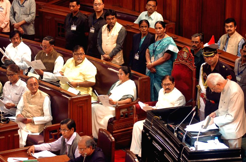 West Bengal Governor Keshari Nath Tripathi addresses on the first day of West Bengal Assembly's Budget session in Kolkata on on Feb 19, 2015. Also seen West Bengal Chief Minister Mamata ... - Mamata Banerjee, Keshari Nath Tripathi, Biman Banerjee and Partha Chatterjee