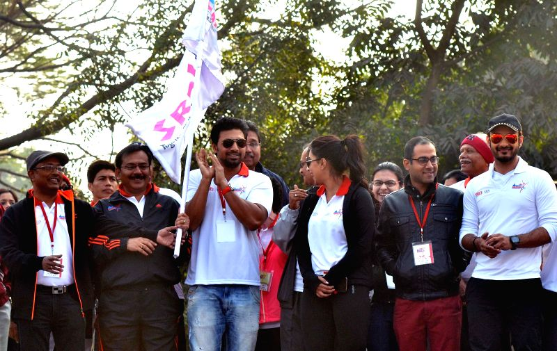 West Bengal Housing Minister Arup Biswas, actor turned politician Dev, actors Sayantika Banerjee, June Malia, Saheb Bhattacharya and others flag off  Kolkata Marathon 2015 in Kolkata, on Feb - Arup Biswas, Sayantika Banerjee, June Malia and Saheb Bhattacharya