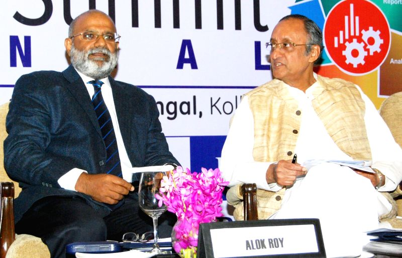 West Bengal Minister Amit Mitra with President of Bengal Chamber of Commerce and Industry during Business Analytics Innovation Summit in Kolkata, on Dec 10, 2014.