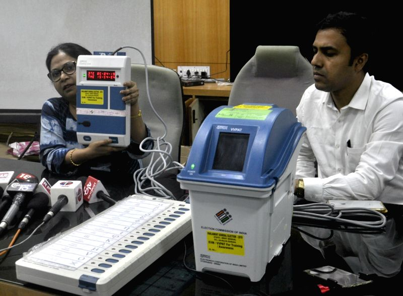 Kolkata: West Bengal's Joint Chief Electoral Officer Anamika Majumder and Deputy Chief Electoral Officer Sumanta Roy demonstrate the usage of Electronic Voting Machine (EVM) and Voter verifiable paper audit trail (VVPAT) during a voter awareness prog
