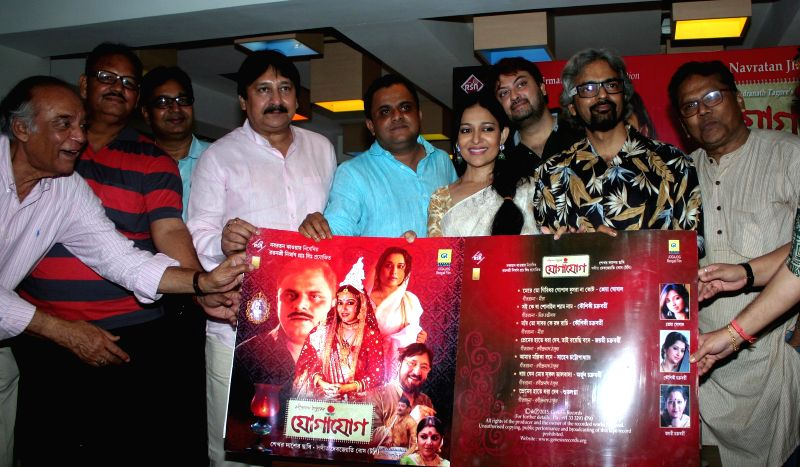 West Bengal Tourism Minister Bratya Basu, actors Arjun Chakraborty and Saheb Chatterjee and Barun Chanda at the audio launch of `Jogajog` in Kolkata, on May 1, 2015. - Bratya Basu, Arjun Chakraborty and Saheb Chatterjee