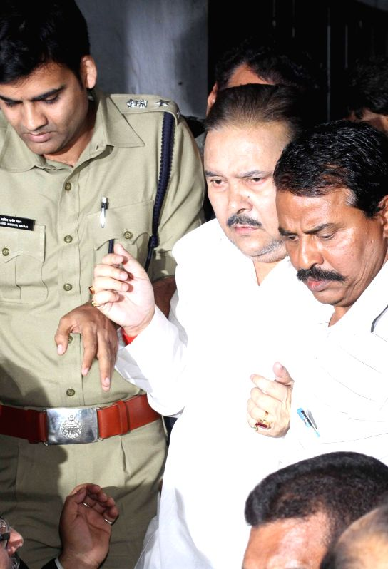 West Bengal Transport Minister and Trinamool Congress leader Madan Mitra being taken to be produced before Alipore court in connection with the multi-crore-rupee Saradha chit fund scam in ...