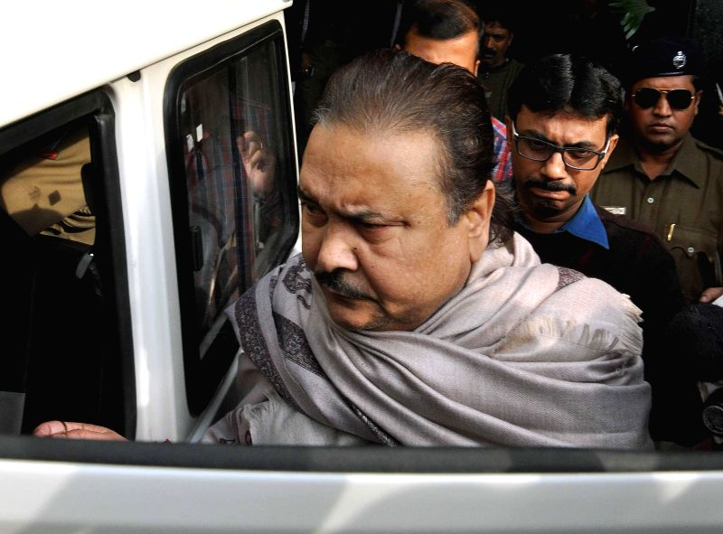 West Bengal Transport Minister Madan Mitra being produced at a court in connection with the multi-crore-rupee Saradha chit fund scam in Kolkata on Dec 13, 2014.