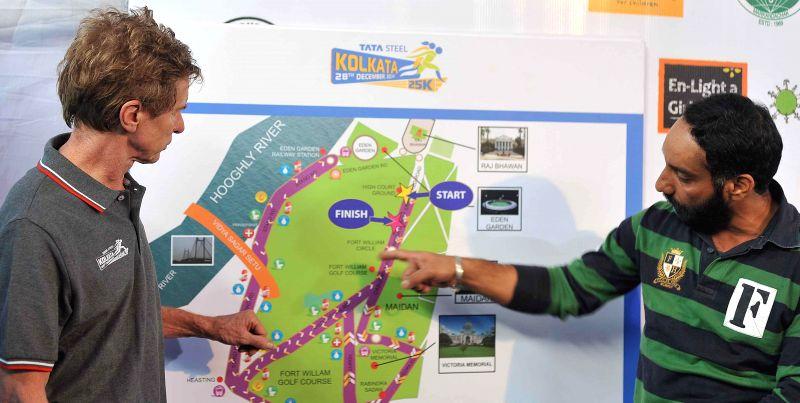 Winner of London marathon 1992 Hugh Jones with Indian blade runner Major Devender Pal Singh during a press conference regarding upcoming 25k marathon in Kolkata, on Dec 26, 2014. - Devender Pal Singh