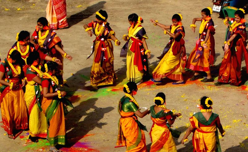 Women celebrate Holi in Kolkata, on March 5, 2015.