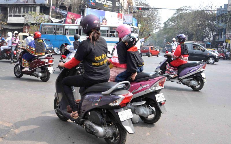 Women participate during a motor bike rally to celebrate `Road Safety Week` at Girish Park in Kolkata, on Feb 10, 2015.