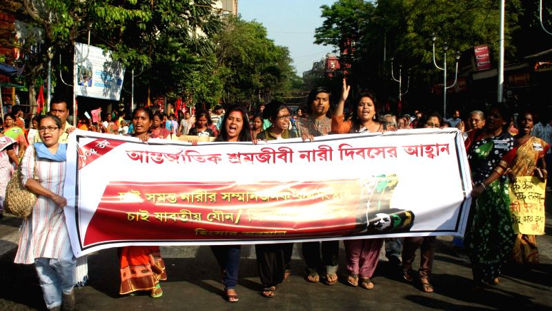 Women participate in a rally organised on the eve of International Women's Day in Kolkata, on March 7, 2015.