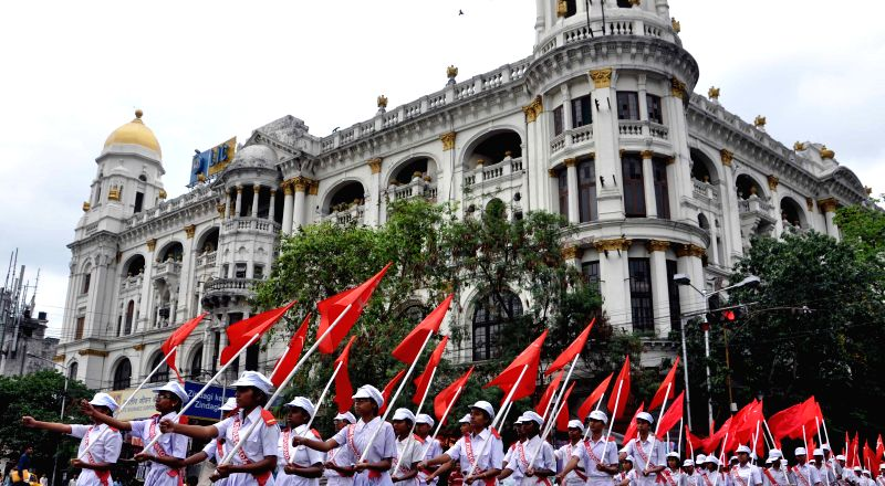 Young Communist wing of SUCI (C) take part in a rally during 67 Anniversary of SUCI Communist celebration in Kolkata on 24 April 2015.