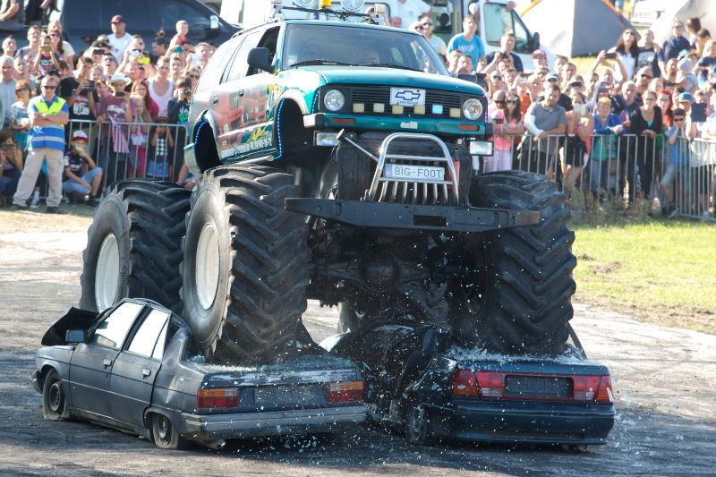 KOMAROM, Aug. 7, 2016 - A monster truck crushes two cars during the International USA Car Festival in Komarom, northern Hungary, on Aug. 6, 2016. (Xinhua/Attila Volgyi)