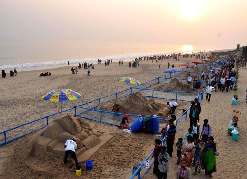 Sand artists participate during a competition organised on the `International Sand Art Festival` held at Chandrabhaga beach, Konark, Puri, Odisha on Dec. 5 2014.