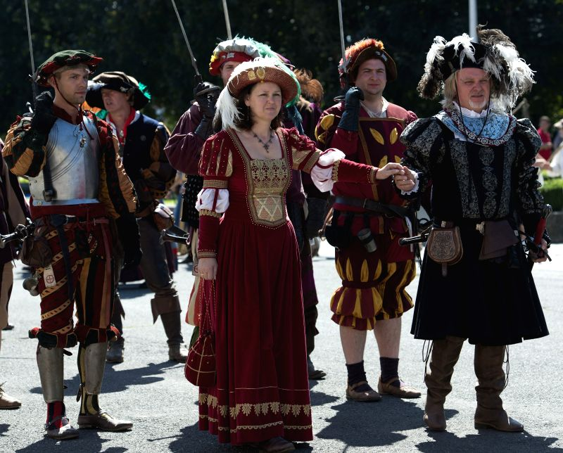 Performers dressed up in historical costumes parade during Renaissance Festival in Koprivnica, northern Croatia, Aug. 30, 2014. More than a thousand people from .