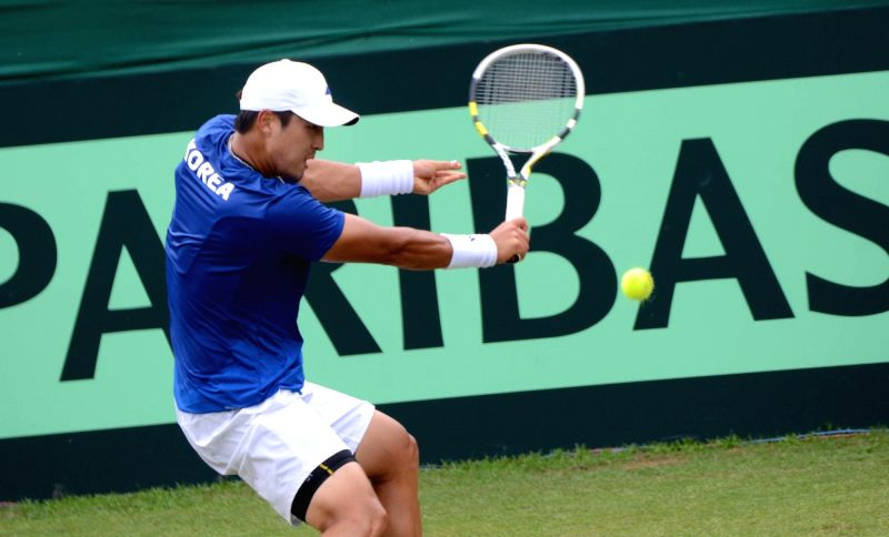 Korea's Yong-Kyu Lim in action against India's Ram Kumar during Asia/Oceania Group I 2nd Round of Davis Cup in Chandigarh on July 17, 2016. - Kumar
